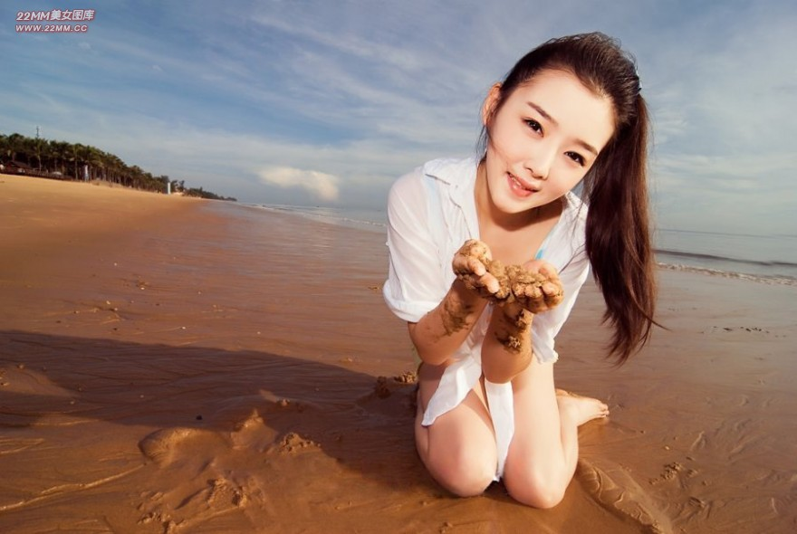 Cute Chinese girl, sexy on the beach.