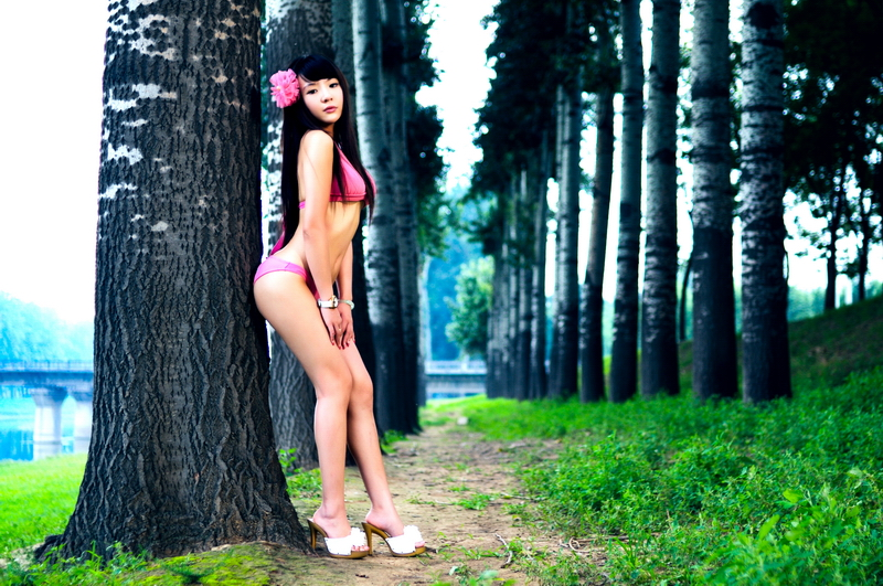 Sexy Asian lady in pink bikini, so cute and very perfect