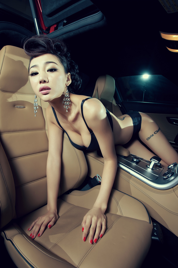 Sexy girl in super car.