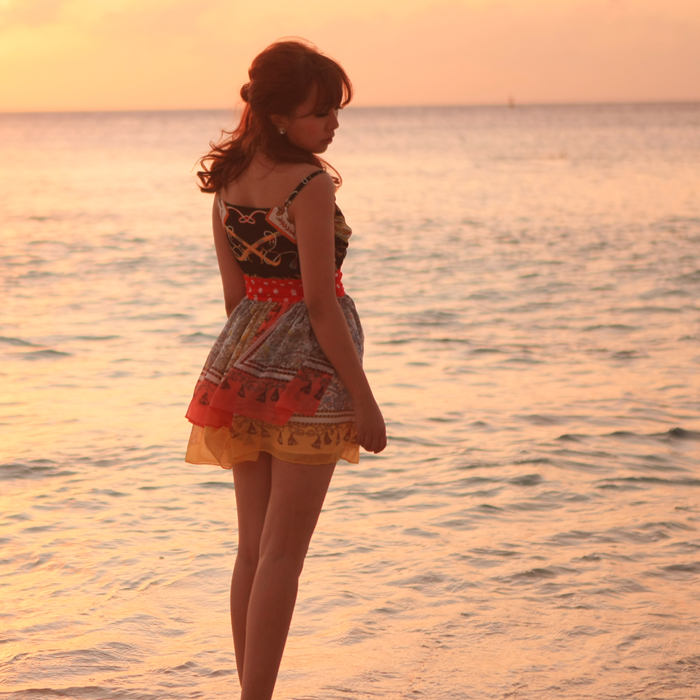 Xiaoyi Liang Yi Chinese Lady Present Beauty Colorful Dress on the Beach